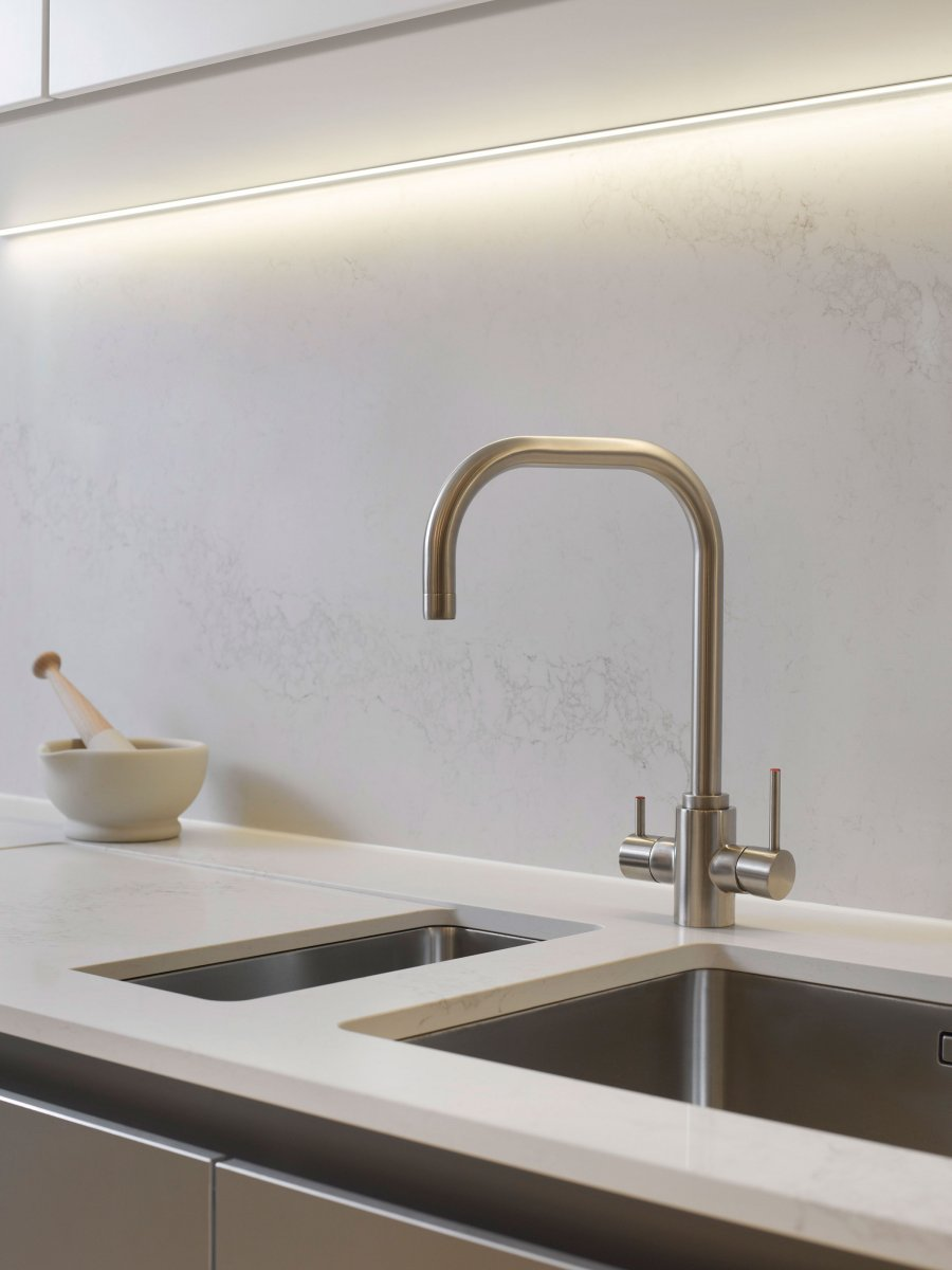 Brushed steel taps and marble splashback in the kitchen