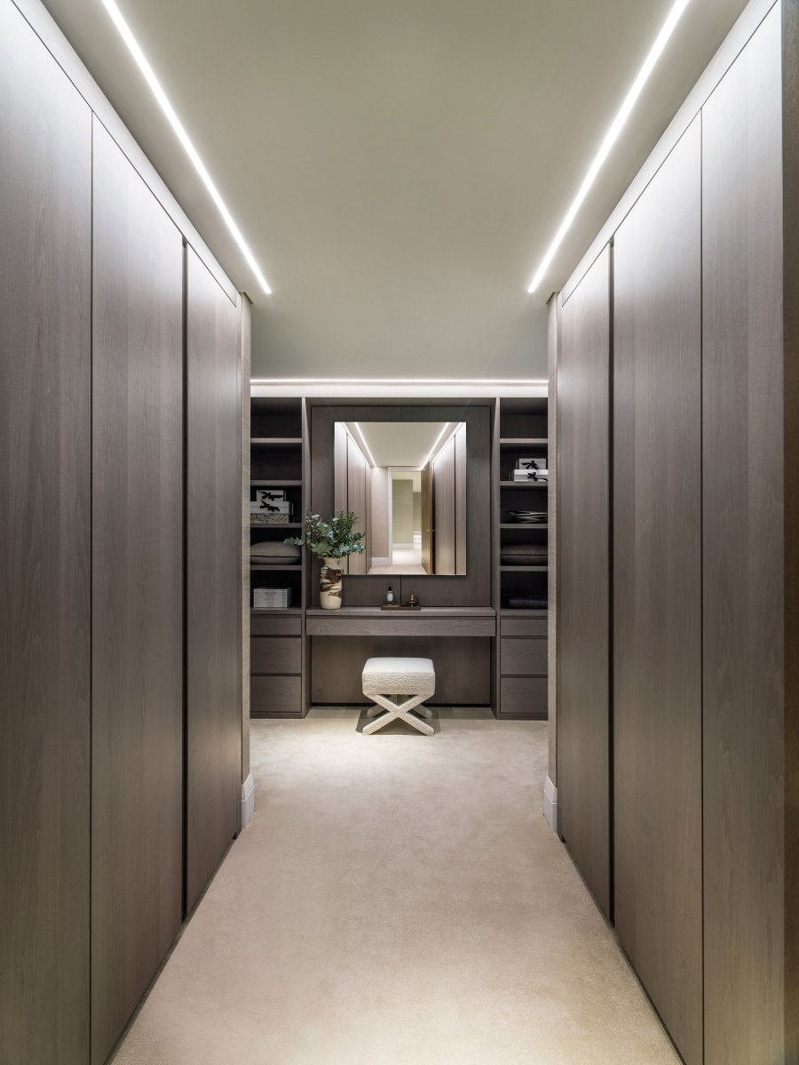 Built-in storage and bespoke cabinetry in a rich timber veneer