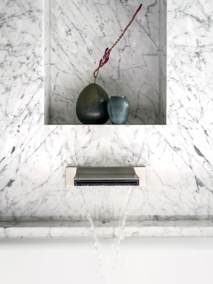A designer Dornbracht bath tap and Statuarietto marble