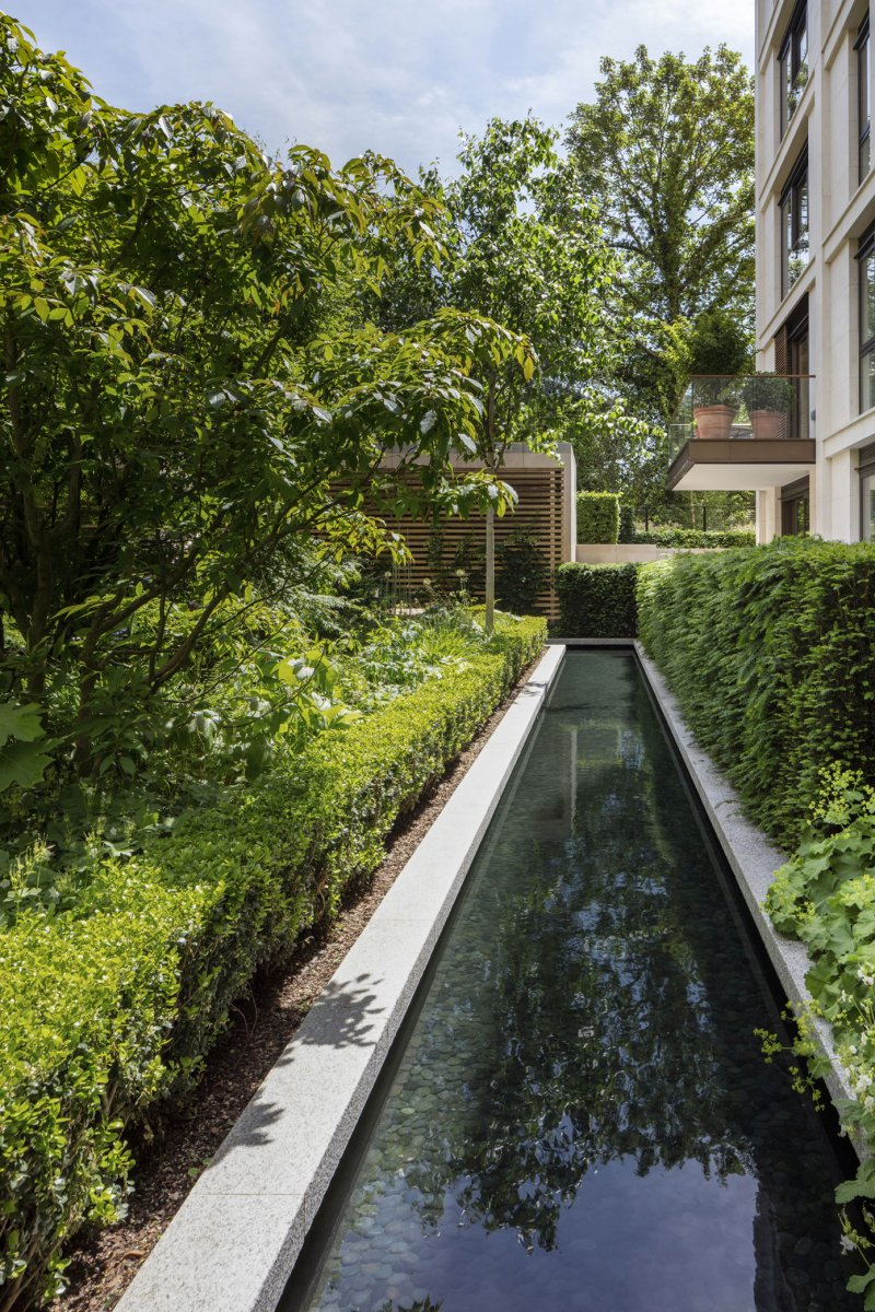 Reflection pools sit within soft planting